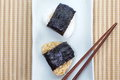 Japanese cuisine rice ball onigiri on bamboo plate Royalty Free Stock Photo