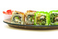 Japanese cuisine: rolls with smoked eel, cucumber, salmon and av Royalty Free Stock Photo