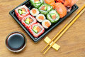 Japanese cuisine: rolls and sushi on a bamboo board close-up. Royalty Free Stock Photo