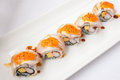 Japanese cuisine salmon eggs and imitation crab nigiri roll sushi Royalty Free Stock Photo