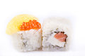 Japanese Cuisine, Sushi Set: roll with salmon, cream cheese, orange, salmon caviar on a white background. Royalty Free Stock Photo