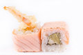 Japanese Cuisine, Sushi Set: salmon roll with tiger shrimp on a white background Royalty Free Stock Photo