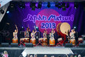 Japanese drummers taiko in traditional costume performing on stage at matsuri festival Stock Photography