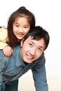 Japanese father and his son play horse-ride Royalty Free Stock Photo