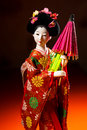 Japanese female kimono doll wearing red paper umbrella with flowers in hair and green glowing tritium trinket