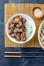 Japanese food. Chicken teriyaki with rice. slate background, top view Royalty Free Stock Photo