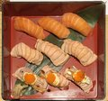 Japanese food cuisine: Salmon Sushi varieties include fresh salmon nigiri, torched aburi fatty salmon sushi and aburi fatty salm Royalty Free Stock Photo