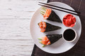 Japanese food: Salmon temaki, ginger and sauce. Horizontal top v Royalty Free Stock Photo