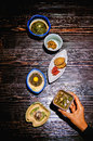 Japanese food side dishes with woman hand Royalty Free Stock Photo