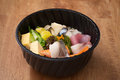 Japanese food Tekka Don take away on wooden background Royalty Free Stock Photo