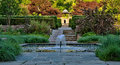 Japanese garden with fountain and pool a is located in the center of a quiet Stock Image