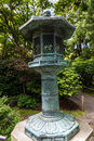 Japanese garden landscape with bronze lantern Stock Images