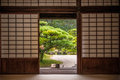 Japanese garden seen through sliding door. Royalty Free Stock Photo