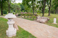 Japanese garden with stone lanterns in a traditional style Royalty Free Stock Photos