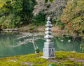 Japanese garden with the stone tower at the Kinkaku temple in Kyoto, Japan Royalty Free Stock Photo