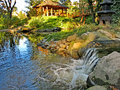 Japanese garden with a waterfall, water pool, pavilion and bridge Royalty Free Stock Photo