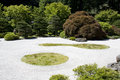 Japanese garden zen rock sand great artwork of raked in portland Royalty Free Stock Image