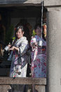 Japanese girl in traditional kimonos Royalty Free Stock Image