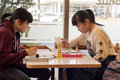 Japanese girls at a coffee shop.