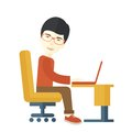 Japanese guy sitting infront his computer Royalty Free Stock Photo