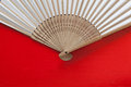 Japanese hand fan made on the red table