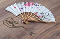 Japanese Hand Fan and Pendant in Shape of Eiffel Tower Royalty Free Stock Photo