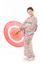 Japanese kimono woman with red traditional umbrella beautiful in white background Stock Photos