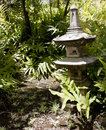 Japanese lantern in a garden Royalty Free Stock Photo