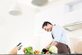 Japanese man cooking food in kitchen Royalty Free Stock Photo