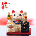 Japanese Maneki-nekos trio Stock Images