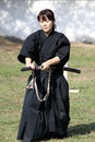 Japanese martial art with katana sword kagawa japan october fighters at marugame iai festival event dedicated to culture and Stock Photos