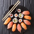 Japanese menu. Tasty set of sushi with salmon and tuna, California rolls, maki, soy sauce closeup. Top view Royalty Free Stock Photo
