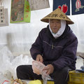 Japanese old farmer man on a vegetables market Royalty Free Stock Photo