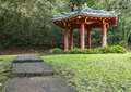 Japanese pagoda pathway leading to a at the byodo in temple in the valley of the temples on oahu hawaii Stock Photos