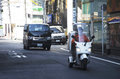 stock image of  Japanese people driving car and riding motorcycle on the road in
