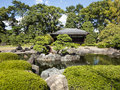 Japanese pond and traditional house in kyoto Stock Photos