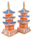 Japanese porcelain pagoda figurines in gold red and blue colours Stock Image