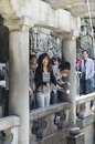 Japanese purification young people taking water from fountain for spiritual in kiyomizudera temple kyoto Royalty Free Stock Image
