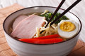 Japanese ramen noodles with pork and egg close up. Horizontal