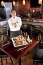 Japanese restaurant chef presenting sushi platter Royalty Free Stock Photo