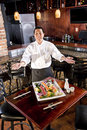 Japanese restaurant chef presenting sushi platter Stock Photography