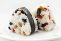 Japanese rice ball balls onigiri on plate over white background Stock Photography