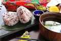 Japanese rice with soup on wooden platter onigiri
