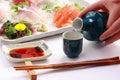 Japanese rice wine Sake and Mixed Sashimi Platter, Japanese food Royalty Free Stock Photo