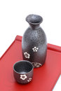 Japanese sake bottle and cup on tray isolated on white background Stock Photography