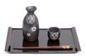 Japanese sake bottle and cup on tray isolated on white background Stock Photo