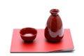 Japanese sake bottle and cups on tray isolated on white background Royalty Free Stock Image