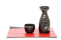 Japanese sake cup and bottle traditional isolated on white background Royalty Free Stock Images