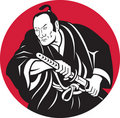 Japanese Samurai warrior drawing sword Royalty Free Stock Photography