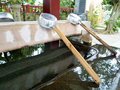 Japanese shrine temizu washing utensils at a used for ritual washing Royalty Free Stock Image